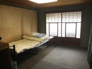 ゲストハウス富貴宿にあるベッド