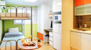A kitchen or kitchenette at BB Hongdae