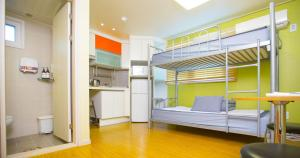 A bunk bed or bunk beds in a room at BB Hongdae