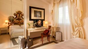 A bed or beds in a room at Arcom Palace