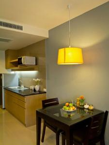 A kitchen or kitchenette at The Grand Wipanan Residence