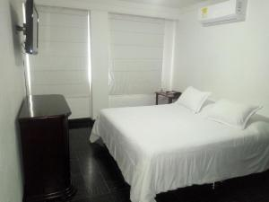 A bed or beds in a room at Vallclaire Suites