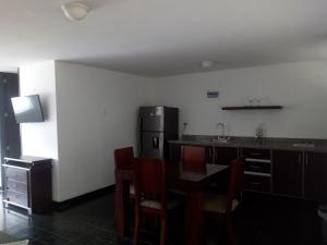 A kitchen or kitchenette at Vallclaire Suites