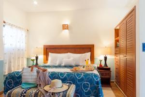 Кровать или кровати в номере Righetto Vacation Rentals