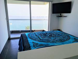 A bed or beds in a room at Nuevo Paracas Apartment