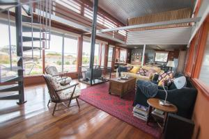 A seating area at Coorong Aurora - breathtaking waterfront escape
