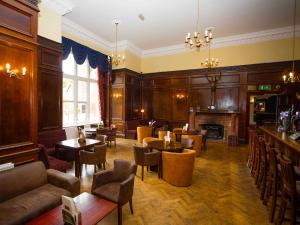 The lounge or bar area at Lynford Hall Hotel