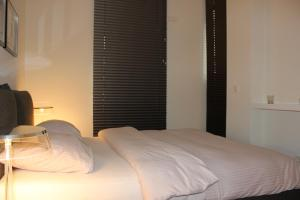 A bed or beds in a room at Luxury Apartment in Andreas Quartier