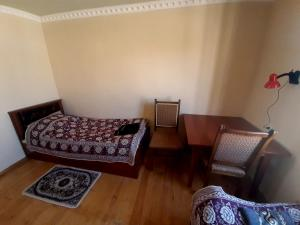 A bed or beds in a room at Art Guest House USTO