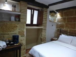 A bed or beds in a room at Ensuite Room First Floor in the center of Old Town
