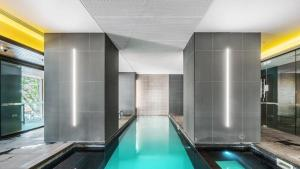 The swimming pool at or near A Modern & Cozy 2BR CBD Apt Near Melbourne Central
