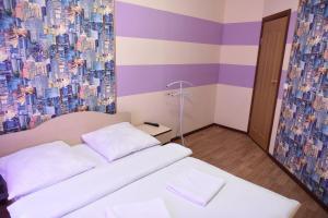 Кровать или кровати в номере Отель Сокол