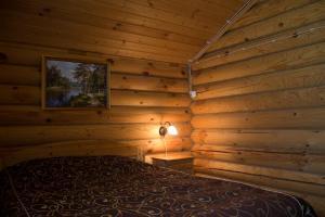 Кровать или кровати в номере Кипревская база отдыха