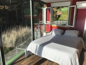 Cama o camas de una habitación en Apartamentos Canabal