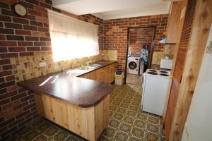 A kitchen or kitchenette at 1/2 Brunswick Avenue