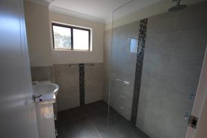 A bathroom at Hawaiian Gardens - Unit 3