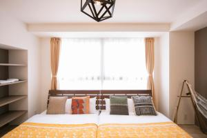 A bed or beds in a room at Minn Umeda-North