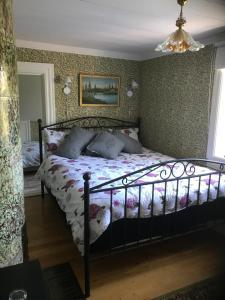 Säng eller sängar i ett rum på Ameriden Bed and Breakfast