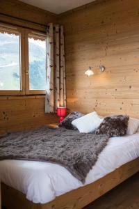 A bed or beds in a room at Vanoise