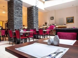 A restaurant or other place to eat at EA Embassy Prague Hotel