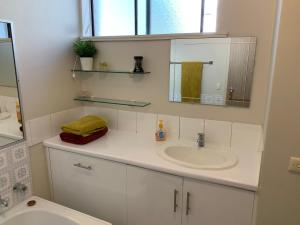 A bathroom at Hurstville home with a view, comfort & style