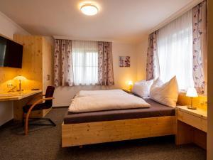 Ein Bett oder Betten in einem Zimmer der Unterkunft Siri's Einkehr