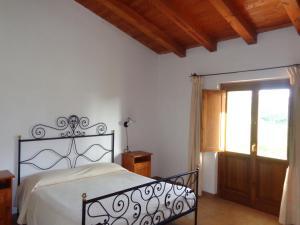Postelja oz. postelje v sobi nastanitve Hotel Su Baione