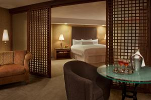 A bed or beds in a room at White Oaks Conference & Resort Spa