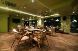 A restaurant or other place to eat at The Orion Plaza - Nehru Place