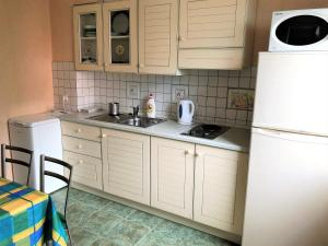 Кухня или мини-кухня в Apartment in Svetlogorsk
