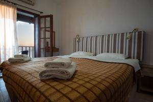 A bed or beds in a room at Villa Kalliopi