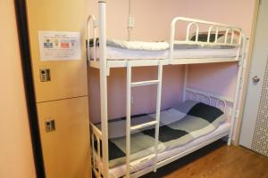 A bunk bed or bunk beds in a room at Busan Sukbak Dot Com Guesthouse