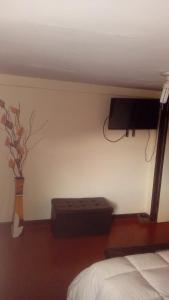 A television and/or entertainment center at Apartment Sumaq Tika