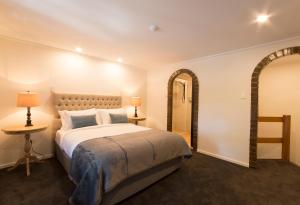 A bed or beds in a room at The Manor Basket Range