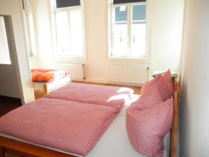 A bed or beds in a room at Altstadthaus