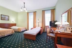 Кровать или кровати в номере Hotel Hetman