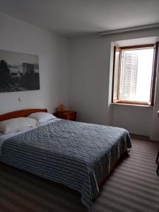 Ein Bett oder Betten in einem Zimmer der Unterkunft Hotel Glavovic
