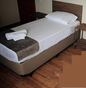 A bed or beds in a room at Rancho XV Hotel