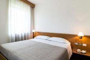 Letto o letti in una camera di Hotel Villa Regina