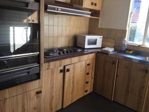 A kitchen or kitchenette at Hendersons Houses