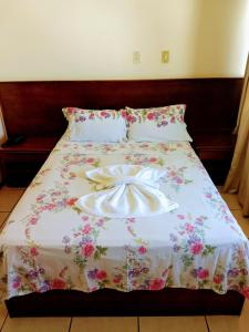 A bed or beds in a room at Flat Barra