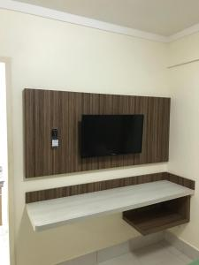 A television and/or entertainment center at Via Caldas L'acqua I
