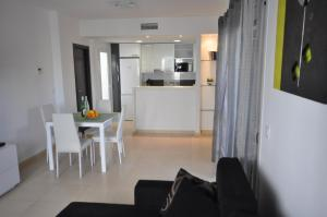 A kitchen or kitchenette at Cozy Apartment in Azul Beach La Mata Torrevieja