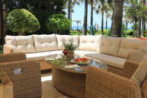Ein Sitzbereich in der Unterkunft Villa Augusto Boutique Hotel & SPA