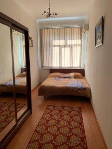 Cama ou camas em um quarto em Apartment Niyazi 5