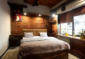 A bed or beds in a room at Apartamenty w Centrum Miasta - Bielsko-Biała