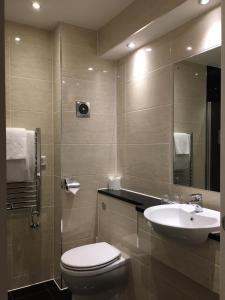 A bathroom at Best Western Heronston Hotel & Spa