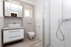 A bathroom at Brand New Apartment in Klimno