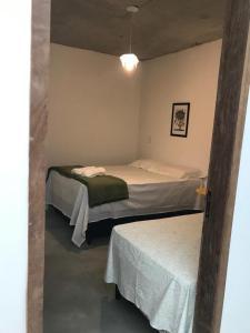 A bed or beds in a room at Casa da Vila Santo Antônio