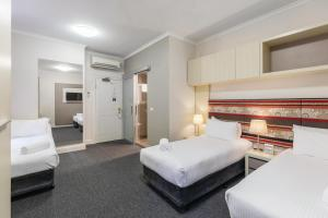 A bed or beds in a room at Best Western Melbourne City